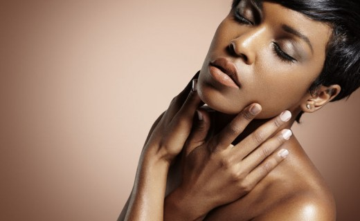 34674331 - black woman with closed eyes touching her face